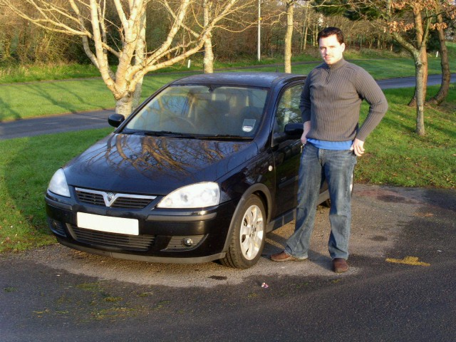 Me and our rental car, the black, 1.4L Vauxhall Corsa.